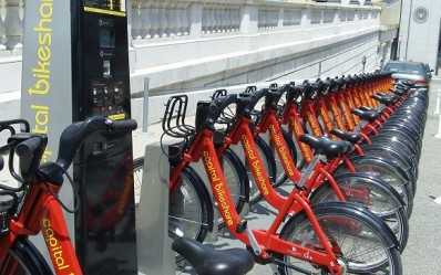 A phalanx of bikes awaits riders at a Capital Bikeshare rental station in Washington, DC. Photo by Akweli Parker