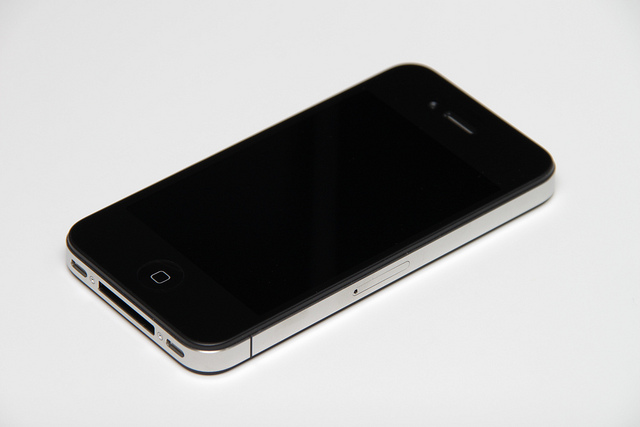 Smartphones carry lots of hidden costs when it comes to sustainability. But the ubiquitous iPhone – specifically the 4S model – gets pretty decent marks in the green manufacturing department. Photo Credit: Flickr user Yutaka Tsutano